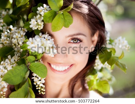beautiful happy brunette woman in the park on a warm summer day