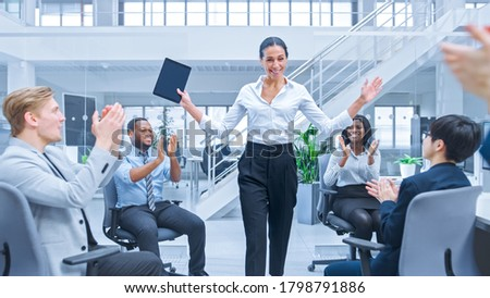 Beautiful Happy Business Woman Manager is Being Cheered and Celebrated by Her Colleagues due to Success. Diverse and Motivated Business People Work on Computers in Modern Open Office. Stock photo ©