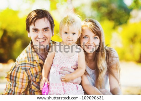 Beautiful happy family enjoying in the park