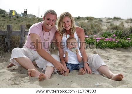 beautiful happy family of three on the beach