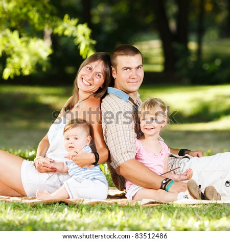 Beautiful happy family resting in the park