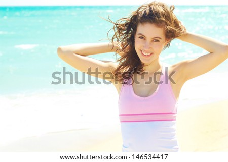 Beautiful happy female enjoying a day at the beach with copy space