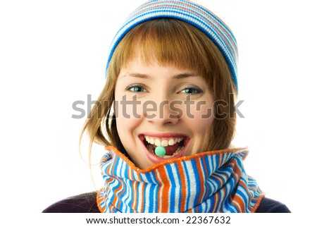 beautiful happy girl taking vitamins isolated against white background