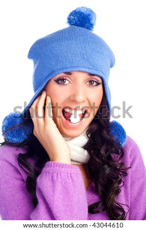beautiful happy girl with tablet in her mouth isolated against white background