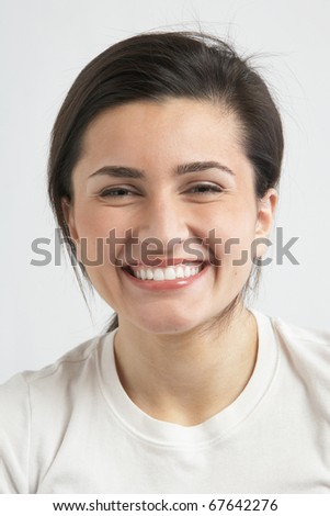 Beautiful happy laughing young woman in white tee shirt