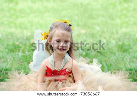 Beautiful happy little girl dressed in a fairy costume.