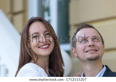 Beautiful happy man and woman over 30, face portrait. A girl is taller than a man. Business partners, a pair of lovers of freelancers. good news, successful business, work in pleasure Foto stock ©