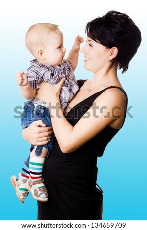 Beautiful happy mather with attractive baby boy o. Portrait of  baby and his mother.