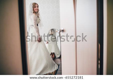 2e4353e4a28 Beautiful happy smile young girl bride. makeup curly hair. the veil.  Morning Bride