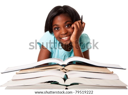 Beautiful happy smiling student with pen and a pile of open books doing homework, isolated.