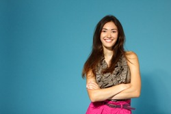 beautiful happy smiling teen girl over blue background