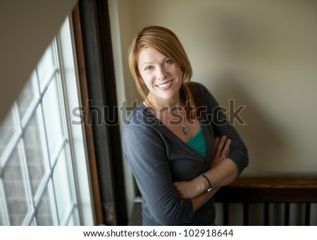 Beautiful happy smiling woman indoor portrait, focus on face