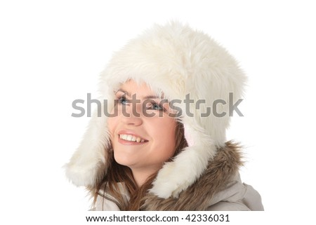 Beautiful happy teen girl with winter fake fur hat isolated on white background #42336031