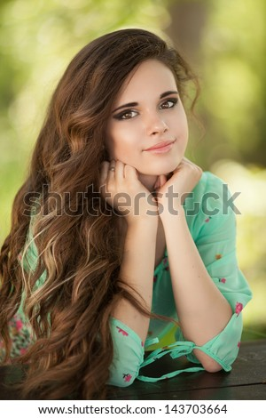 beautiful happy woman girl smiling outdoors in green