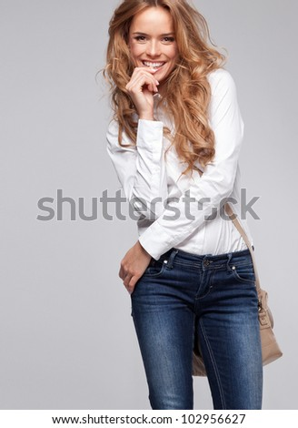 Beautiful happy woman holding a bag