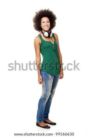 Beautiful happy woman holding headphones, isolated on white backgorund