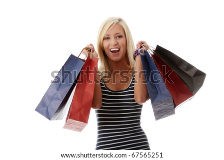 Beautiful happy woman holding shopping bags.