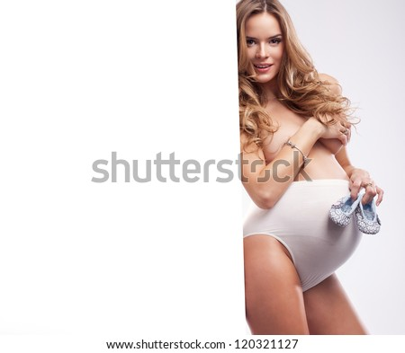 Beautiful happy woman in pregnant