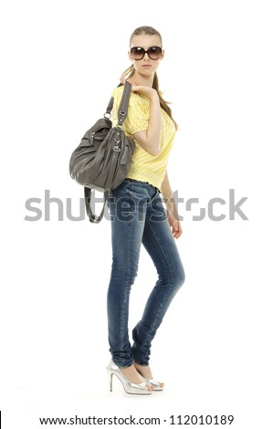 Beautiful happy woman in sunglasses holding a bag