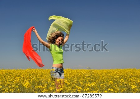 beautiful happy woman on rapeseed field in bloom