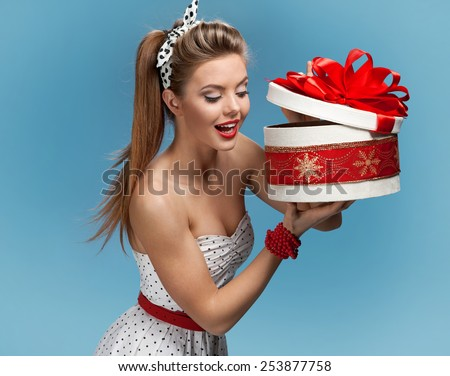Beautiful happy woman opening gift box / set photos of beautiful young retro pinup woman on blue background