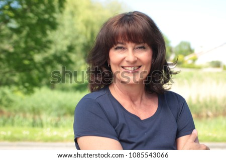 Beautiful happy woman outside