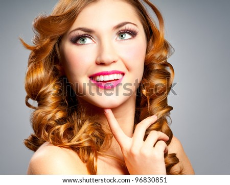 Beautiful happy woman with gold curly hair