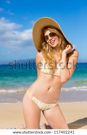 Beautiful Happy Young Woman Relaxing in the Sun on Tropical Beach