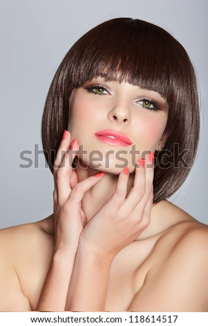 beautiful happy young woman wearing short bob hairstyle on studio background