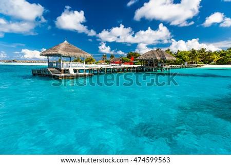 Beautiful harbor bridge in island of Maldives. Perfect tropical island paradise beach Maldives. Luxury summer travel holiday vacation background concept. #474599563