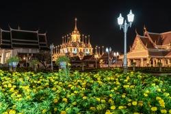 Beautiful HDR Marigold flower in the night light at Loha Prasat Wat Ratchanatda, Bangkok, Thailand