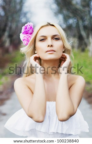 Beautiful Healthy Girl over nature background.Outdoor