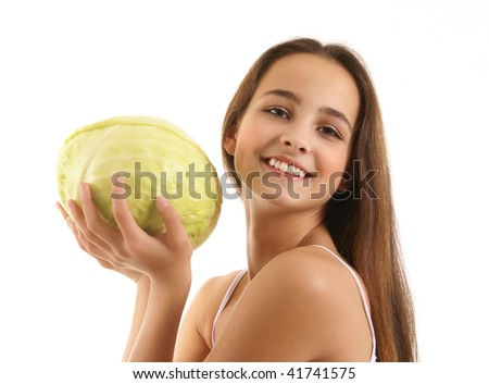 Beautiful healthy girl with cabbage