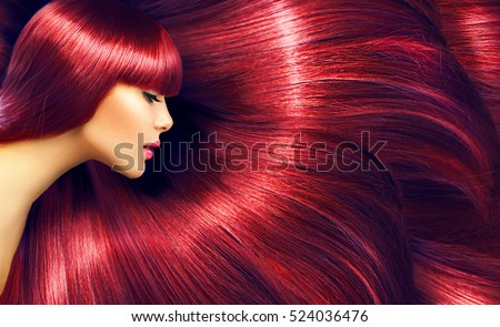 Beautiful Healthy Hair. Beauty woman with luxurious long red hair as background. Beauty Model girl. Beautiful woman with long smooth shiny straight hair. Hairstyle. Hair cosmetics, haircare