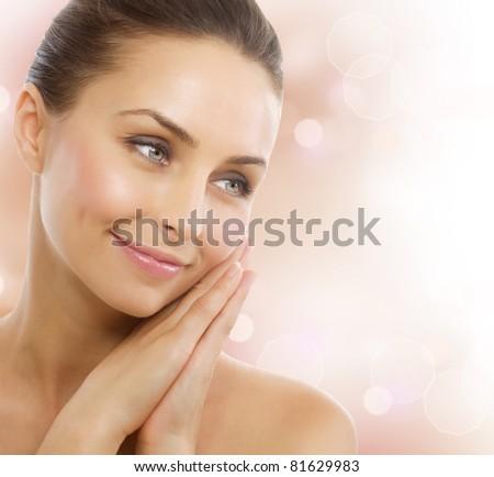 Beautiful Healthy Woman touching her skin