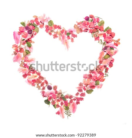 Beautiful heart of dry rose isolated on white