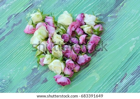 Beautiful heart of flowers roses on green background #683391649