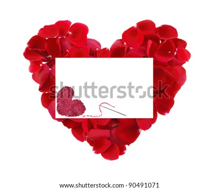 beautiful heart of red rose petals and greeting card with textile heart and needle isolated on white