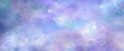 Beautiful heavens above celestial concept background banner - beautiful blue pink purple green lilac light filled heavenly ethereal cloud scape depicting the heavens above