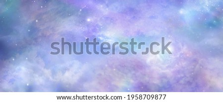 Beautiful heavens above celestial concept background banner - beautiful blue pink purple green lilac light filled heavenly ethereal cloud scape depicting the heavens above   Photo stock ©