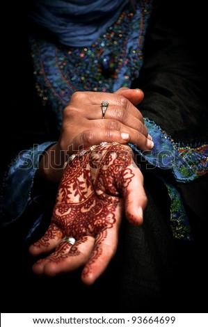 Beautiful henna tattoo in a bride's hand 01 - body art