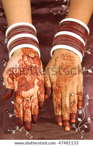 Beautiful henna tattoo on bride's hand