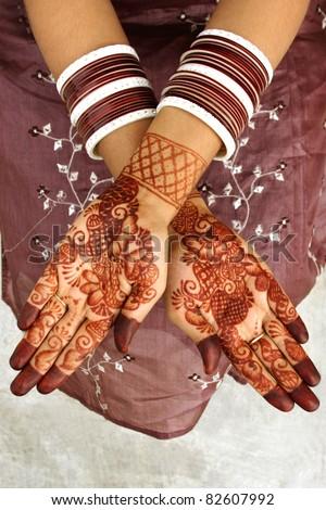 Beautiful henna tattoo on bride's hand