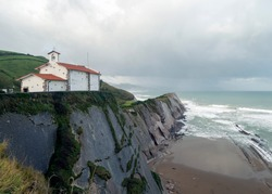 Beautiful hermitage of San Telmo dedicated to the patron saint of sailors located on a high cliff formed on a flysh over the beach of Zumaia, Guipuzcoa, Spain.