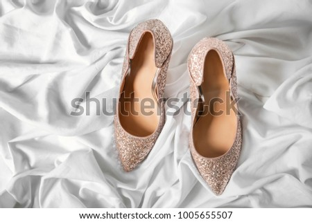 Beautiful high heeled shoes on white fabric #1005655507