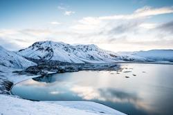 Beautiful highland iceland blue lake near Hekla among snow mountains.