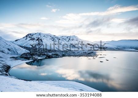 Stock Photo Beautiful highland iceland blue lake near Hekla among snow mountains.