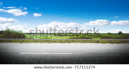 Beautiful highway road. Summer day landscape background #717111274
