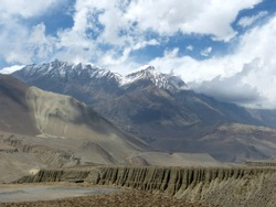 Beautiful Himalayan mountains and scenic cliffs in Mustang, Nepal. Scenic mountain landscapes of the kingdom of Mustang. Cloudscape in the sky. Muktinath. Kali Gandaki. Annapurna circuit. Dhaulagiri.