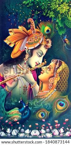 Beautiful Hindu God Radha Krishna With Peacock Feather background Wallpaper Design Stock photo ©
